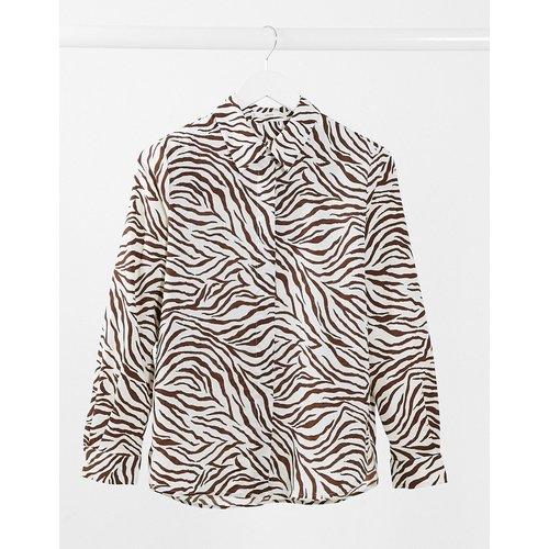 Zebra - Chemise boutonnée à imprimé zèbre - Mango - Modalova
