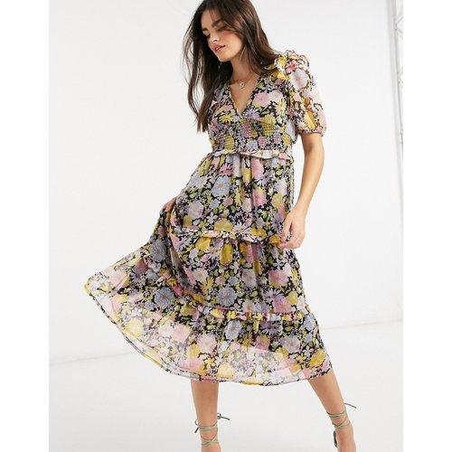 Robe mi-longue avec jupe à volants étagés et nœud dans le dos - Motif à fleurs - Neon Rose - Modalova