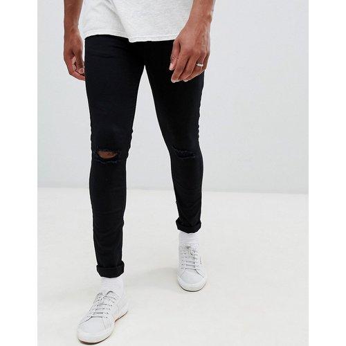Jean skinny avec déchirures aux genoux - délavé - New Look - Modalova