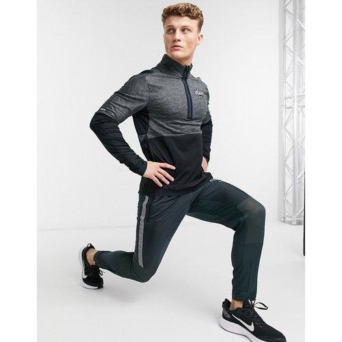 Wild Run Element - Top à fermeture éclair 1/4 - Nike Running - Modalova