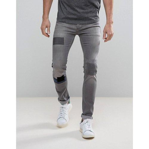 Jean skinny stretch effet rapiécé - Religion - Modalova