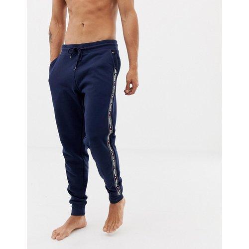 Pantalon de jogging confort authentique resserré aux chevilles à bandes griffées sur les côtés - Bleu marine - Tommy Hilfiger - Modalova