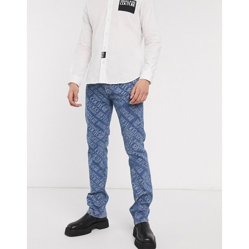 Jean skinny avec logo sur l'ensemble - Versace Jeans Couture - Modalova