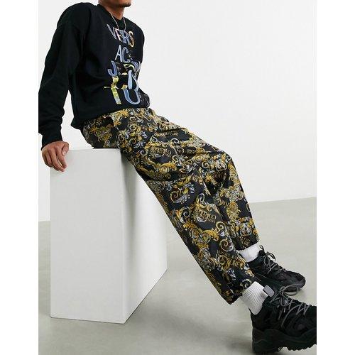 Jogger à imprimé baroque - Versace Jeans Couture - Modalova