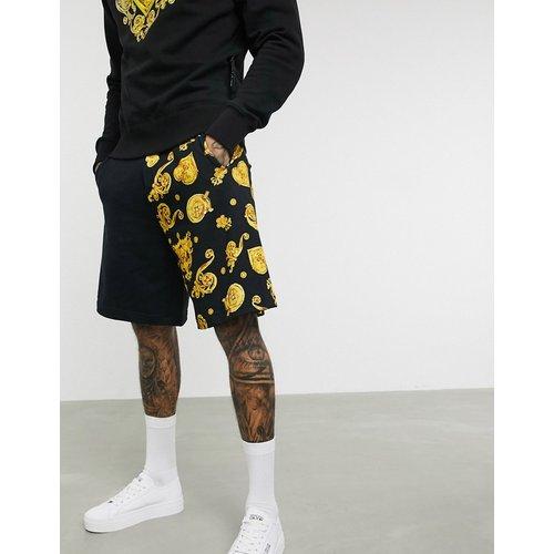 Short en jersey à jambes en deux tissus dont motif baroque - Versace Jeans Couture - Modalova