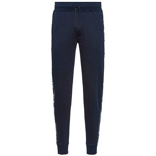 Pantalon de jogging Regular Fit à bandes logo - HUGO - Modalova