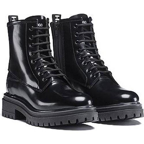 Boots à lacets en cuir italien brillant - HUGO - Modalova
