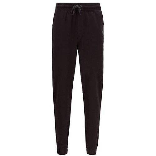 Pantalon Relaxed Fit en molleton de coton avec finitions en gomme - Boss - Modalova