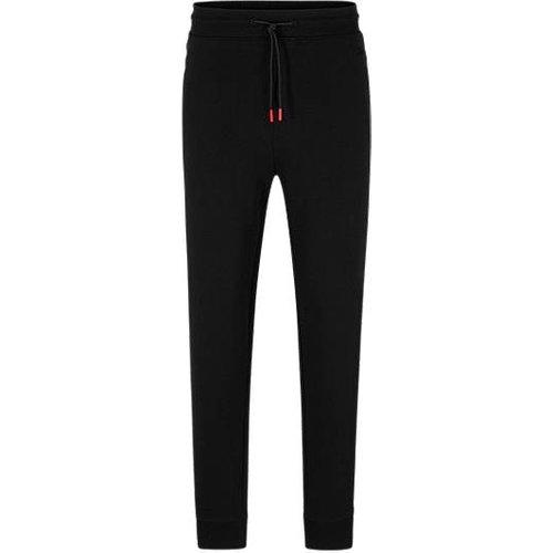 Pantalon de survêtement en molleton de coton à rayures et logo contrastants - HUGO - Modalova