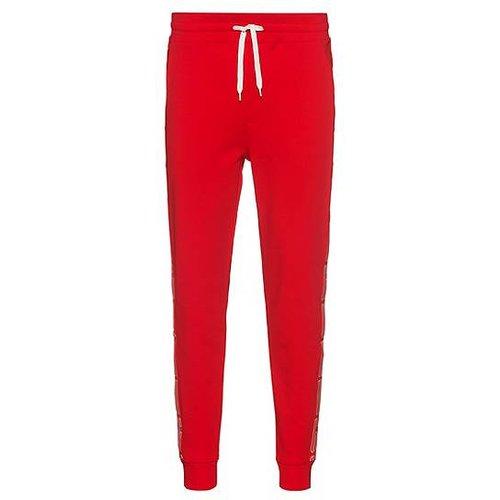 Pantalon de survêtement en coton interlock avec bandes logo latérales - HUGO - Modalova