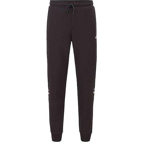 Pantalon de survêtement en jersey doubleface rehaussé de logos - Boss - Modalova