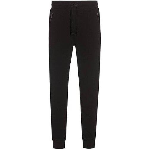Pantalon de survêtement en molleton de coton mélangé avec poches zippées - HUGO - Modalova