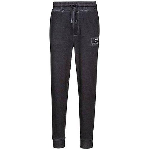 Pantalon de survêtement teint en pièce en coton Recot²® - HUGO - Modalova