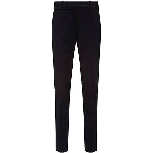 Pantalon Slim Fit en laine vierge stretch infroissable - HUGO - Modalova