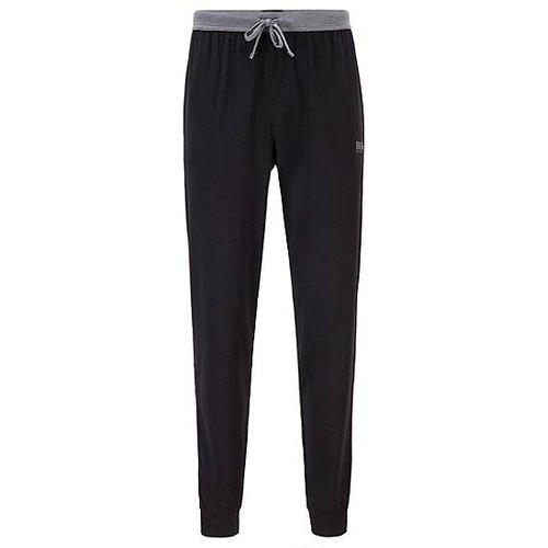 Pantalon de pyjama en coton mélangé resserré au bas des jambes, avec passepoils contrastants - Boss - Modalova