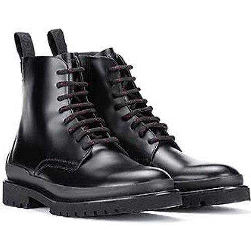 Bottines en cuir brossé inspirées des chaussures de randonnée - HUGO - Modalova