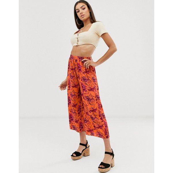 ab120be902 - Gonna a pantalone pratica elasticizzata arancione con stampa tropicale -