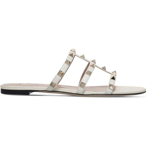 VALENTINO   Valentino Rockstud leather slide sandals   Goxip