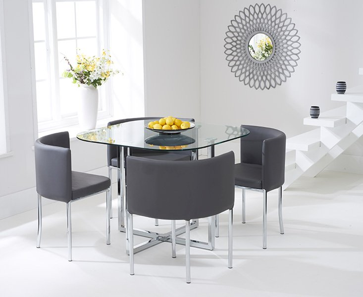 Photo of Algarve glass stowaway dining table with grey high back stools