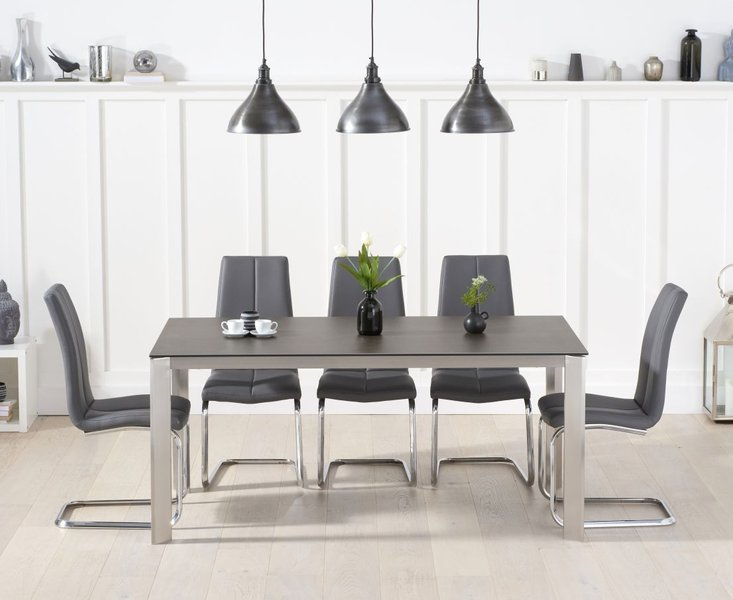 Photo of Antonia 170cm mink/brown spanish ceramic dining table with tarin faux leather chairs