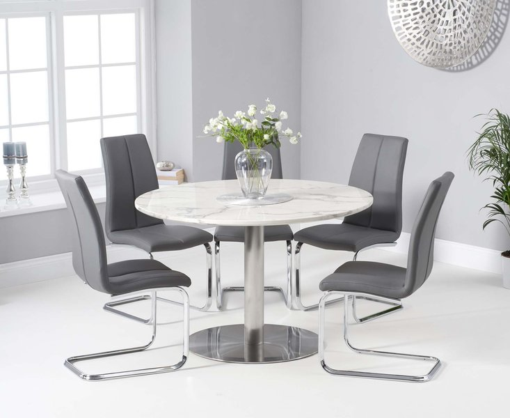 Photo of Baha 120cm round white marble dining table with tarin chairs