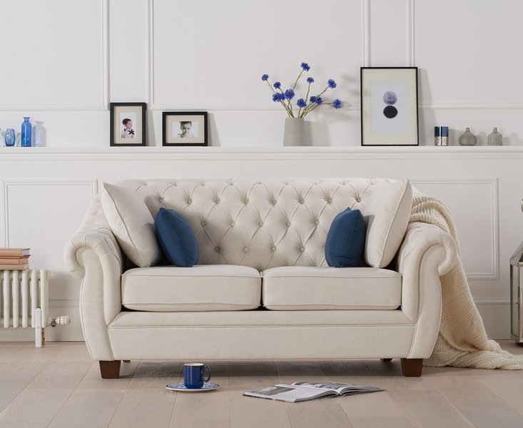Photo of Lacey chesterfield ivory linen fabric two-seater sofa