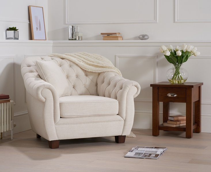 Photo of Lacey chesterfield ivory fabric armchair