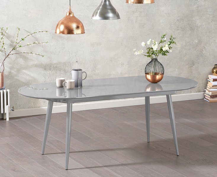 Photo of Olivia extending light grey high gloss dining table
