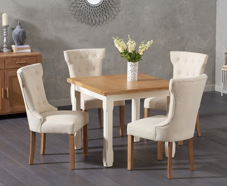 Photo of Somerset 90cm flip top oak and cream dining table with cora cream fabric chairs