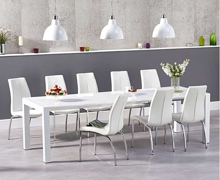 Photo of Ex-display joseph extending white high gloss dining table with 4 black cavello chairs