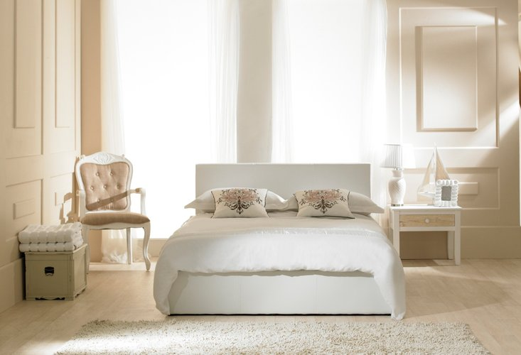 Photo of Madrid faux leather white ottoman bed