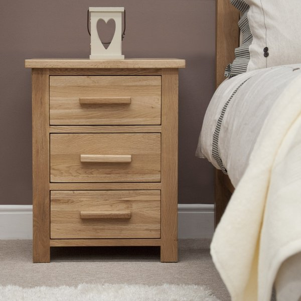Photo of Rohan oak three-drawer bedside cabinet