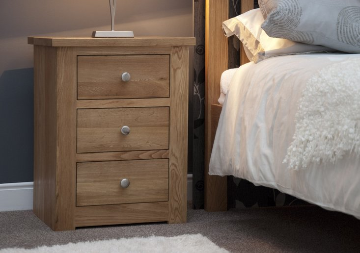 Photo of Messina oak three drawer bedside chest
