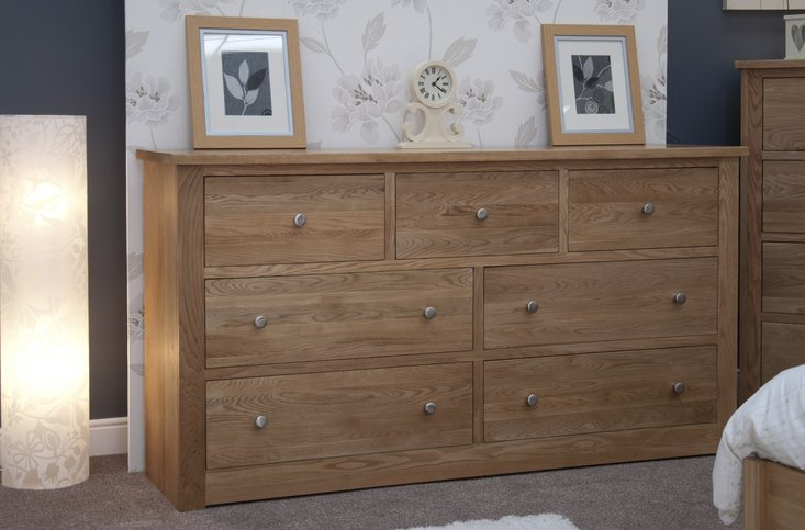 Photo of Messina oak 7 drawer wide chest