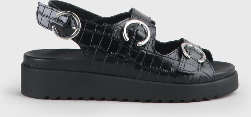 Artikel klicken und genauer betrachten! - Mit diesem innovativen Schuh ziehst Du garantiert alle Blicke auf Dich! Die Justa Sandale aus Leder vereint gleich mehrere Trends: Hier trifft das schwarze Upper aus Leder auf ein cooles Riemchen-Design und anpassbare Schnallen. Derweil lässt es sich dank des 4 cm hohen Plateaus ausgesprochen komfortabel laufen. Features: in Schwarz breite Riemen mit Schnallen-Verschluss 4 cm hohes Plateau in Kroko-Optik | im Online Shop kaufen