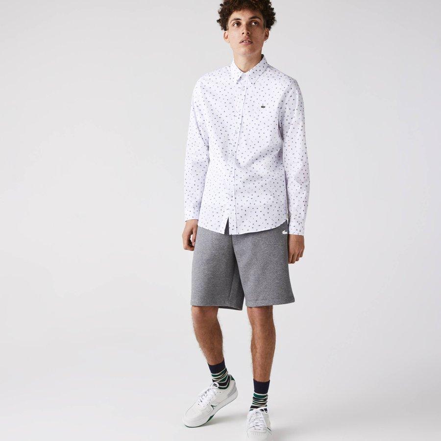 Artikel klicken und genauer betrachten! - Lassen Sie sich das neue Muster dieses Hemds aus leichtem Baumwoll-Popeline nicht entgehen. Raffinierte Abschlüsse und kultige Knöpfe werten dieses Essential auf. Mit einem grünen Krokodil verziert, gehört das Teil im trendigen Slim Schnitt definitiv in Ihren Kleiderschrank.   im Online Shop kaufen