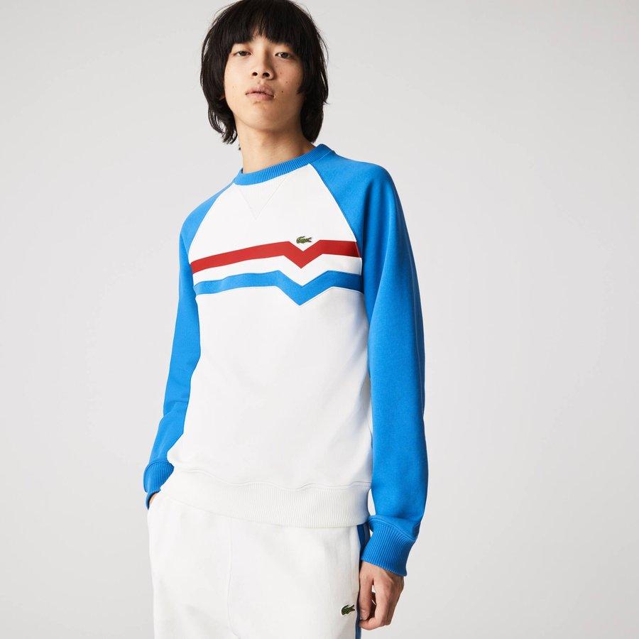 Artikel klicken und genauer betrachten! - Kontrast-Raglanärmel und Trikolor-Streifen machen dieses Sweatshirt der Made in France Kollektion aus. Aus Bio-Baumwollfleece gefertigt, im angenehmen Schnitt. Das kultige Krokodil zeigt sich in den Streifen dieses kultigen Teils.   im Online Shop kaufen