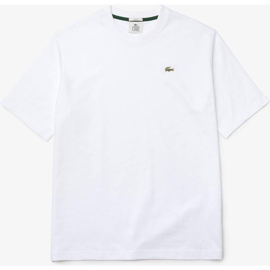 Artikel klicken und genauer betrachten! - Dieses LACOSTE L!VE T-Shirt aus Baumwolljersey ist einfach ein Premium-Basic. Das geradlinige Design und das grüne Metallkrokodil heben dieses neue Unisex-Essential hervor. Ein zeitloses Essential - ein Must-Have für jeden Anlass.   im Online Shop kaufen
